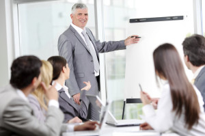 Man with chart presentation to group medium